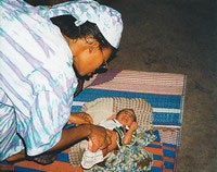 Sister Felicitas is called to check a new-born infant in the village