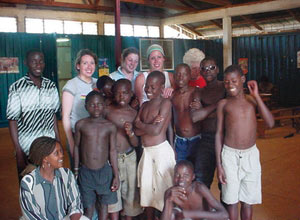 Visiting students meet Sister Helen Ahern's education programme for street children